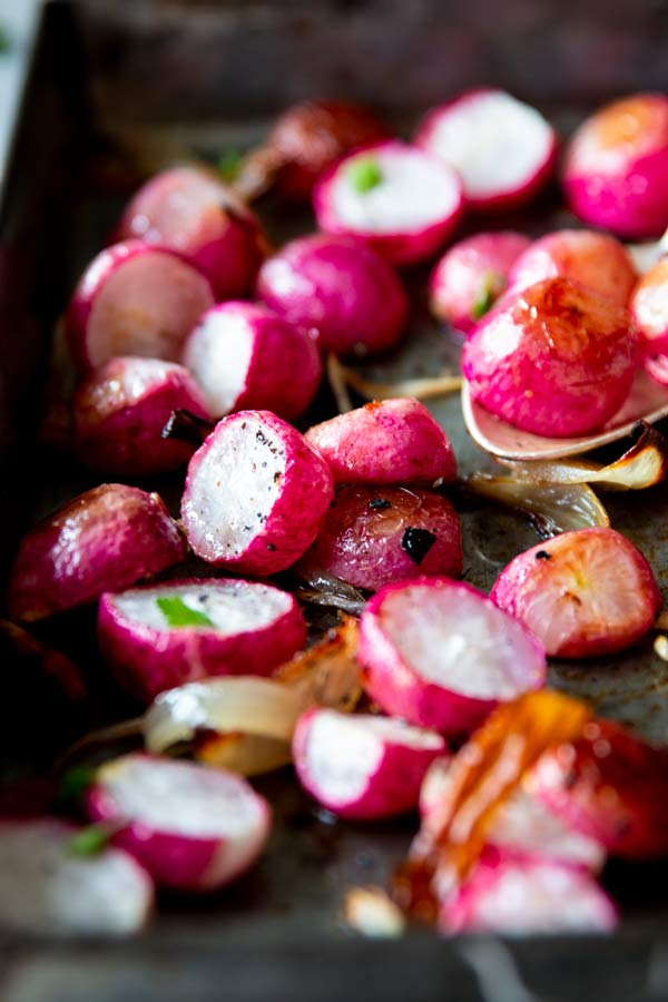 roasted radish's on a dark baking sheet