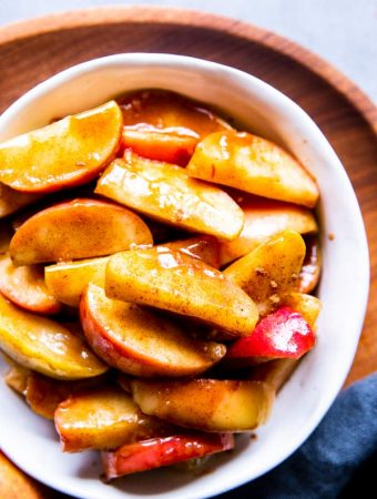 healthy cinnamon apples in a white bowl