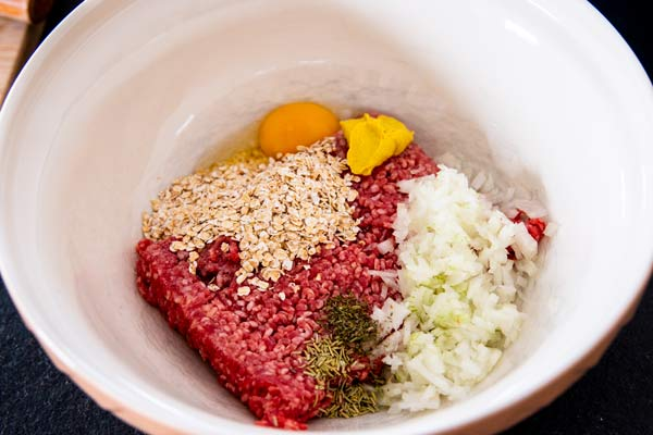 meat for meatballs with oats, onion, egg and herbs