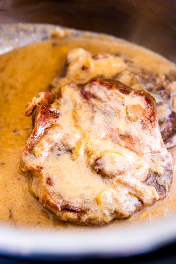 close up photo of sour cream pork chops in the instant pot