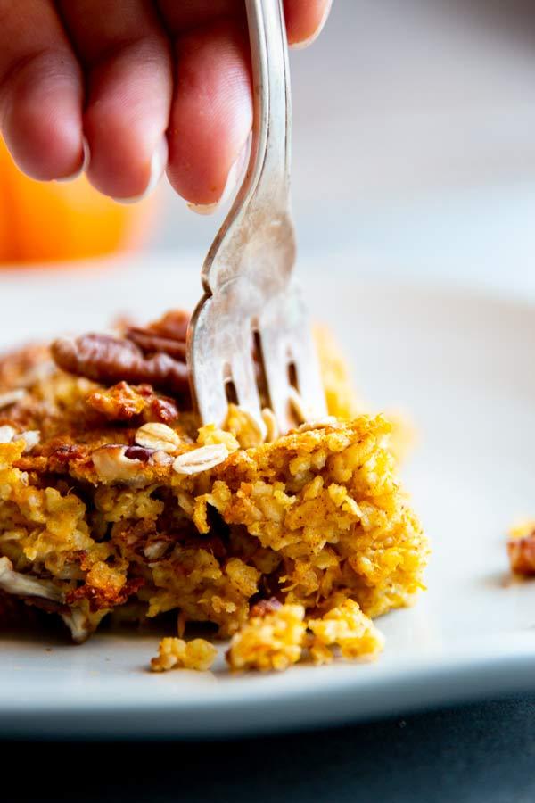 fork in a piece of pumpkin baked oatmeal