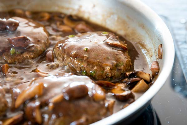salisbury steak cooking in mushroom gravy