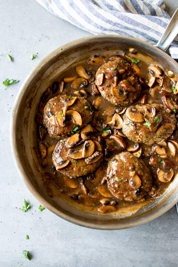 salisbury steak with mushroom gravy in a skillet