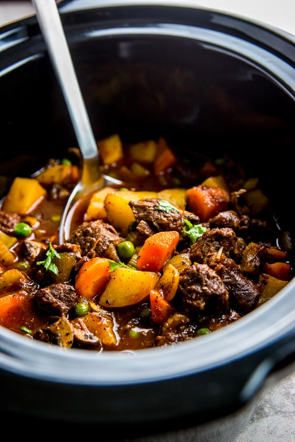 slow cooker beef stew in a black crock