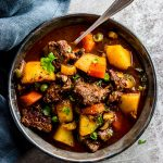 slow cooker beef stew in a black bowl