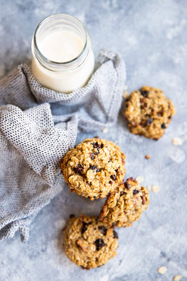 cranberry walnut breakfast cookies with milk on the counter