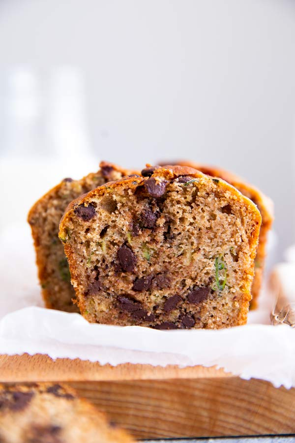 sliced healthy chocolate chip zucchini bread on a wooden chopping board