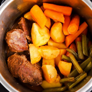 pressure cooker with ingredients for pot roast