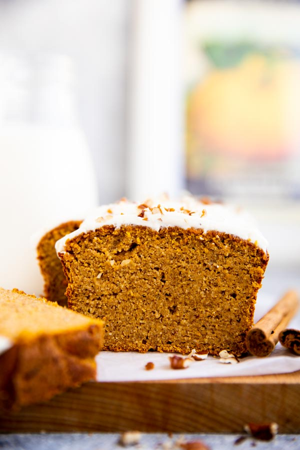slice of keto pumpkin bread in front of a milk bottle
