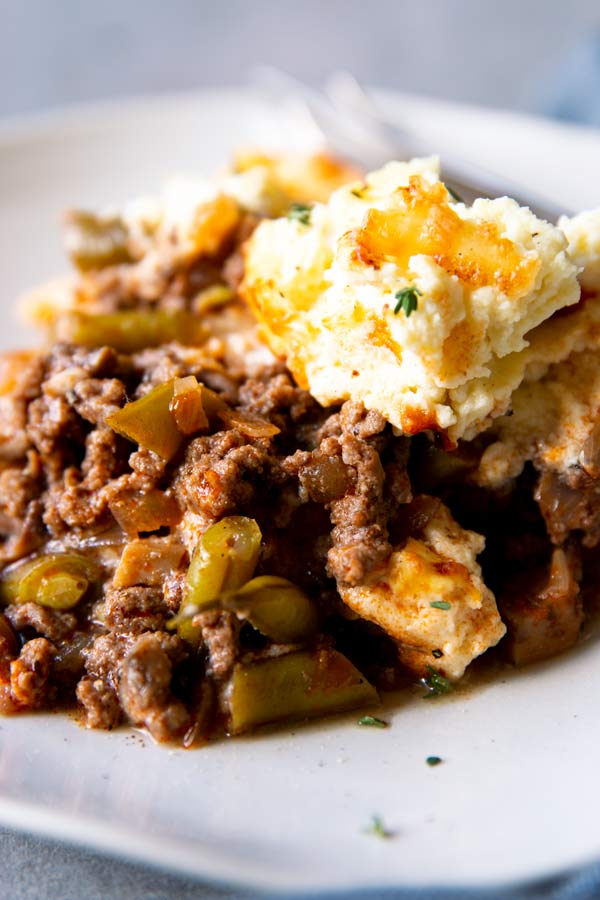 close up view of portioned out shepherd's pie with low carb cauliflower topping