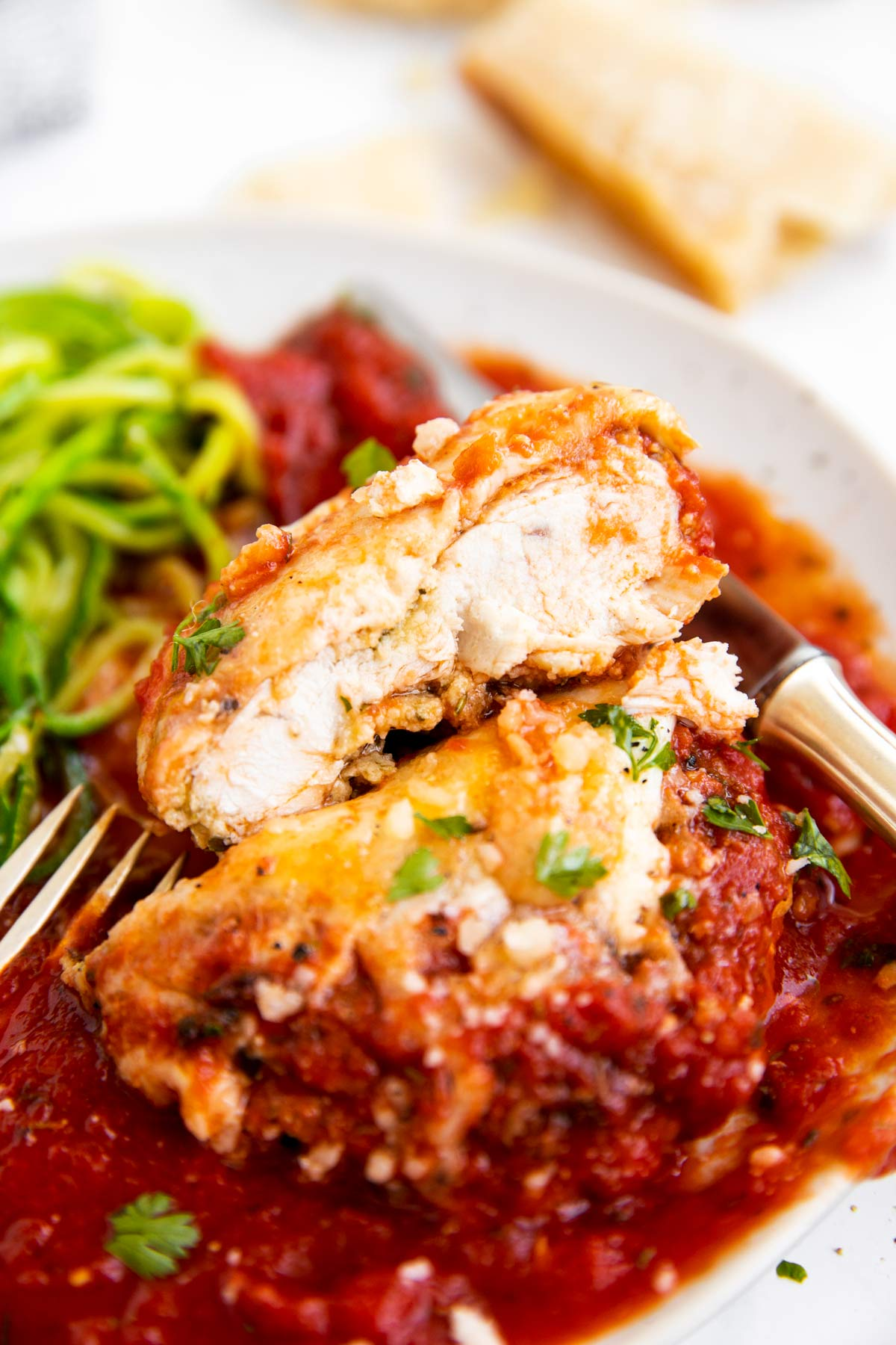 close up of sliced open chicken parmesan