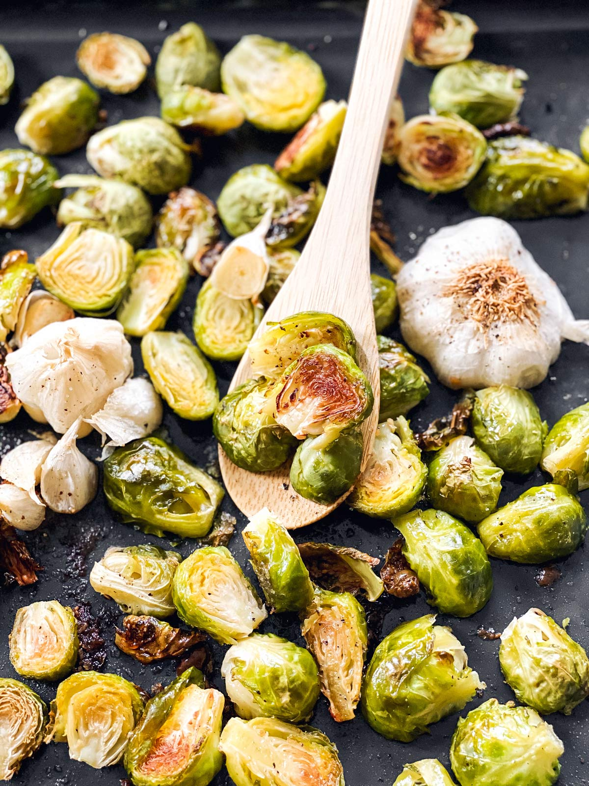 close up photo of garlic roasted Brussels sprouts on a sheet pan