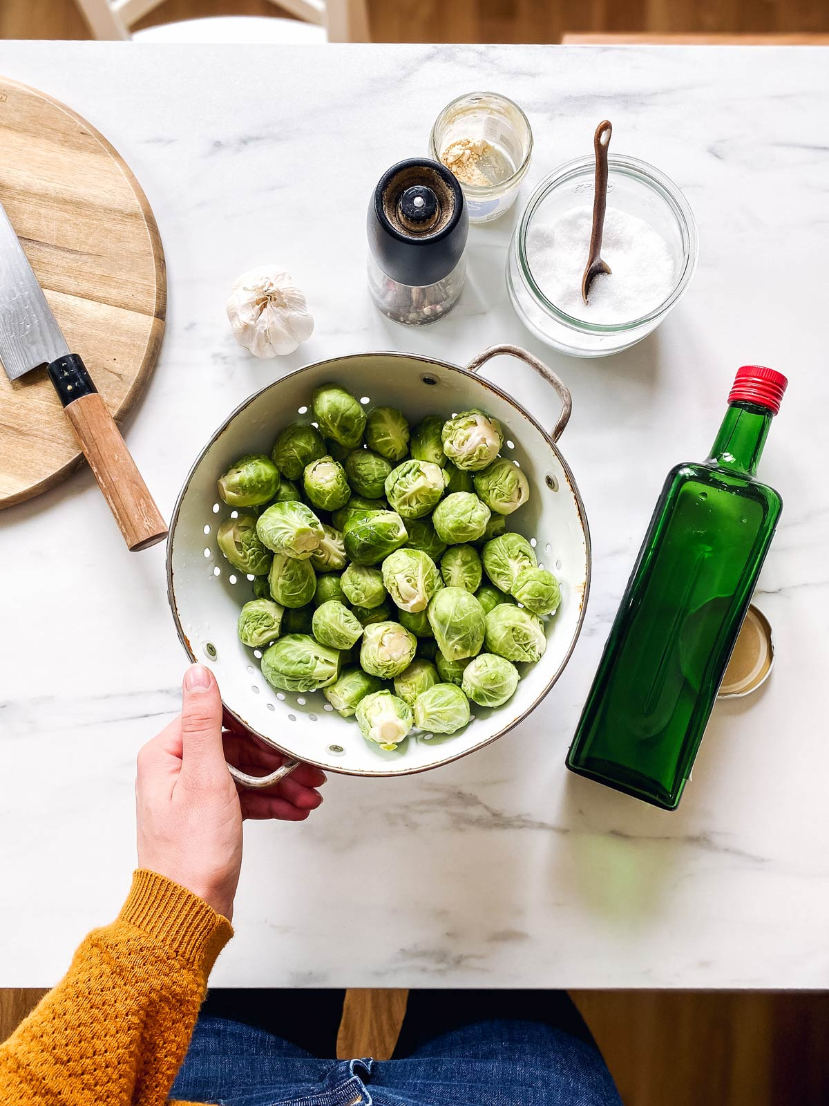 ingredients for roasted Brussels sprouts on a marble counter