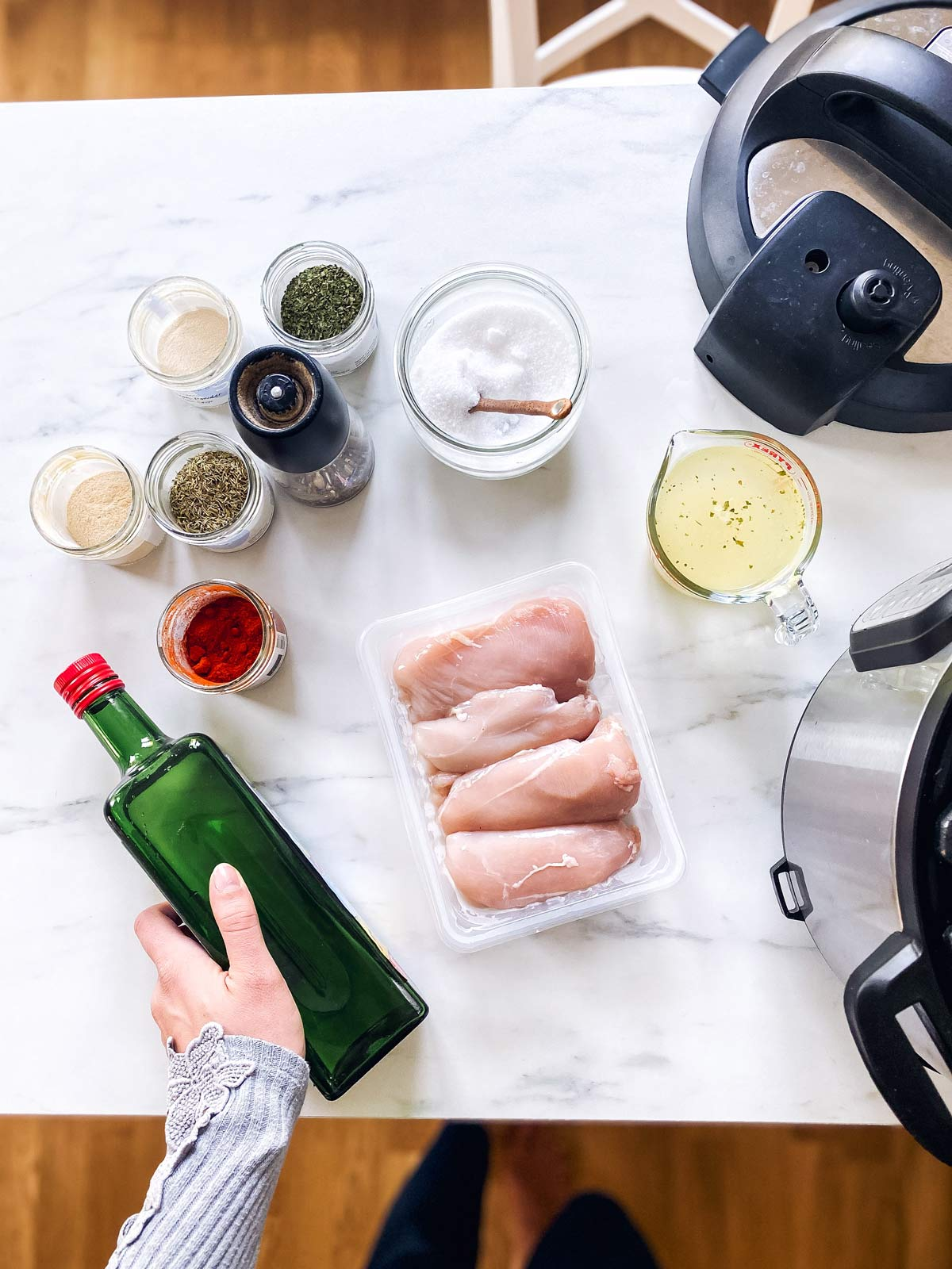 ingredients to make instant pot chicken breast on a marble counter