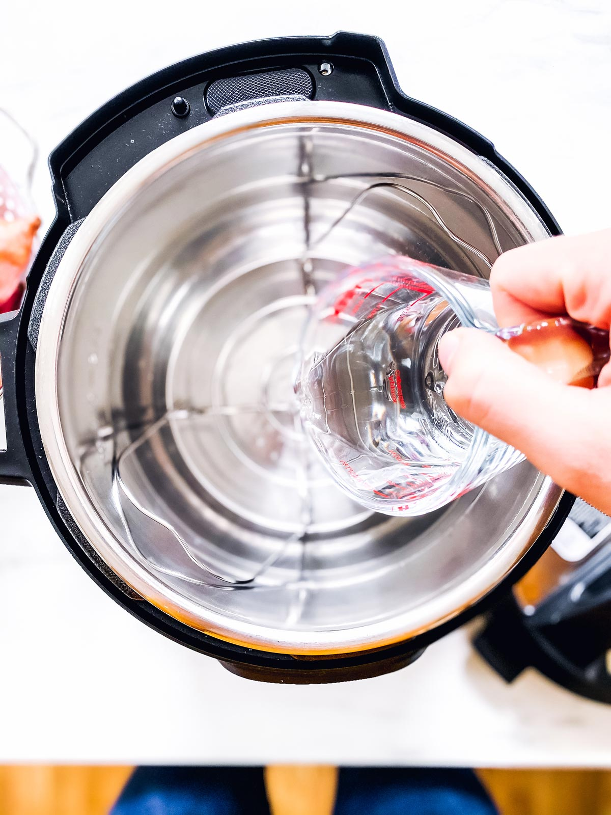 pouring water into instant pot