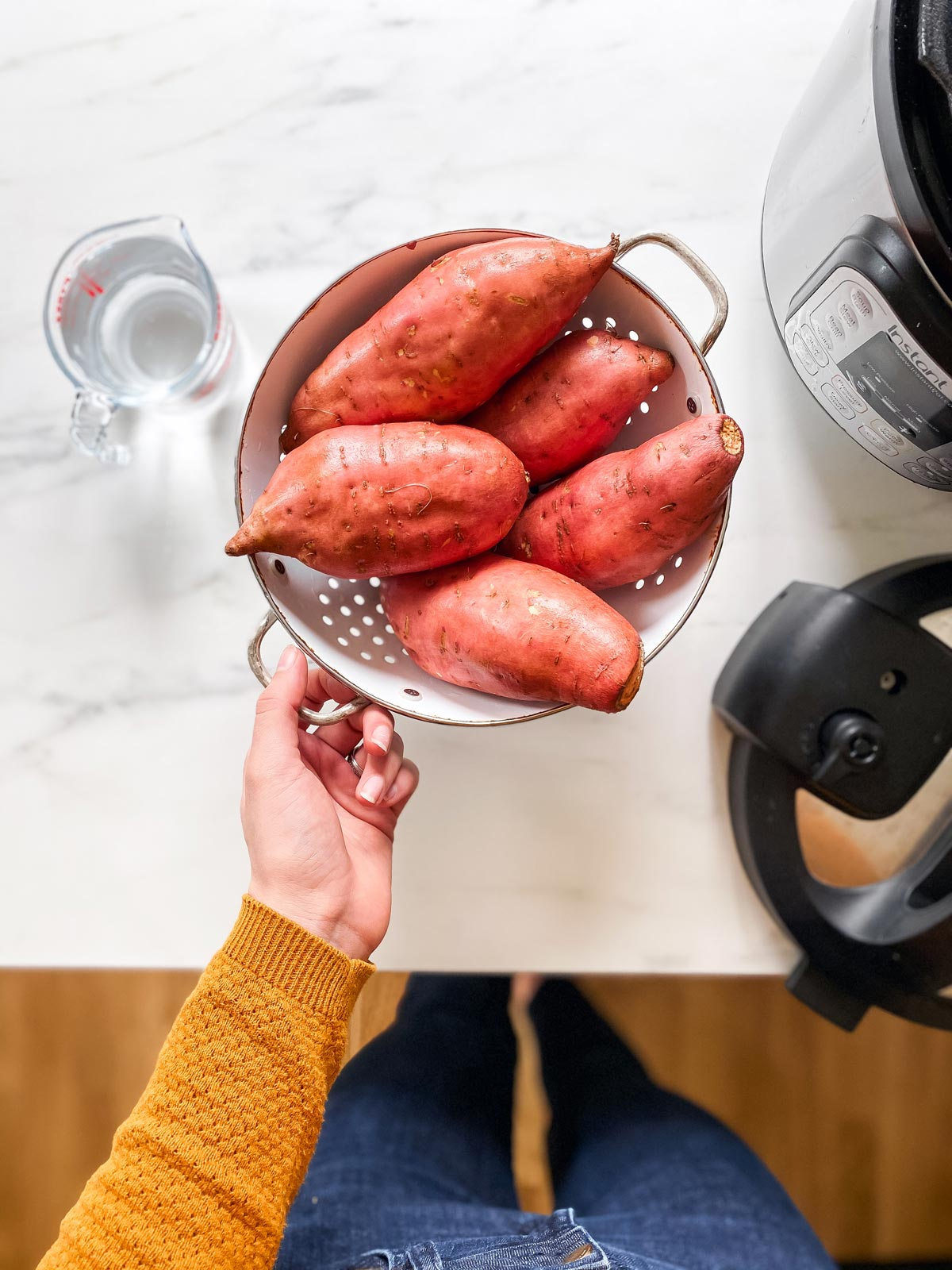 sweet potatoes in a colander on the counter