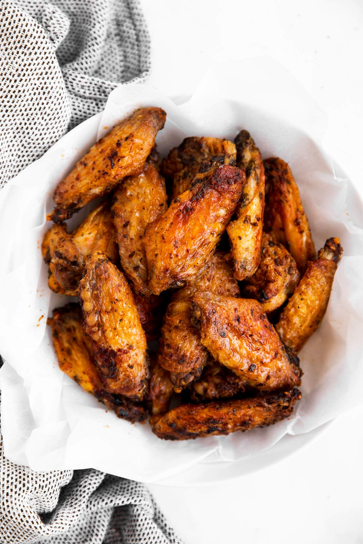 overhead view of chicken wings in a white bowl