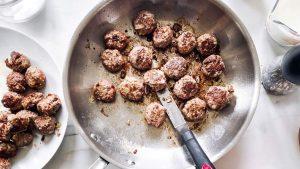 browned meatballs in skillet