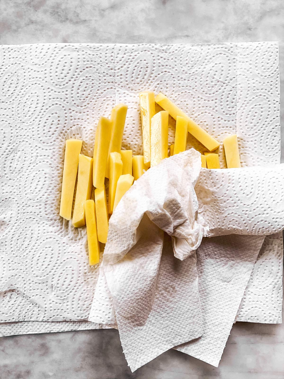 raw French fries on paper towels