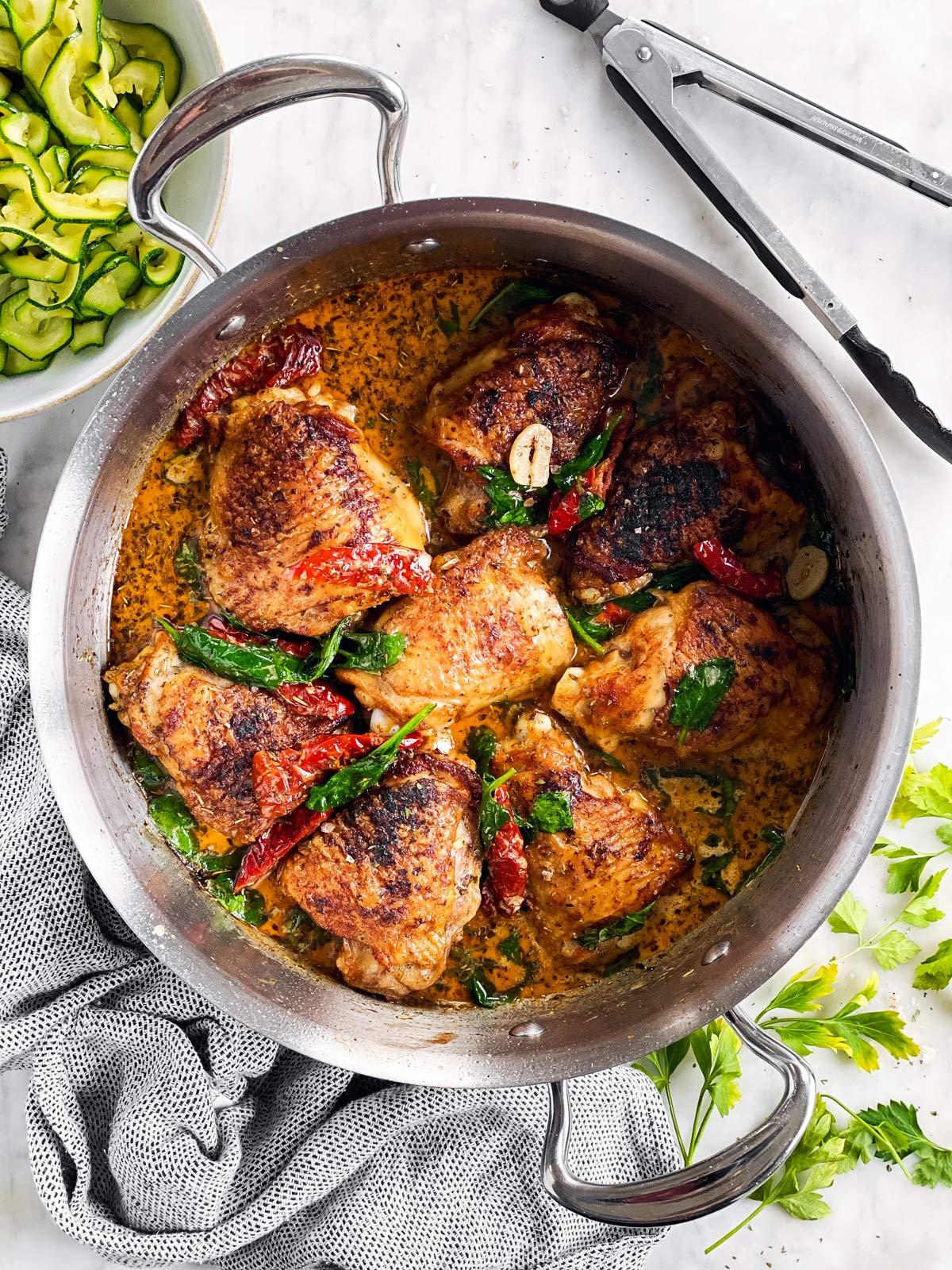 chicken thighs in creamy sauce in skillet