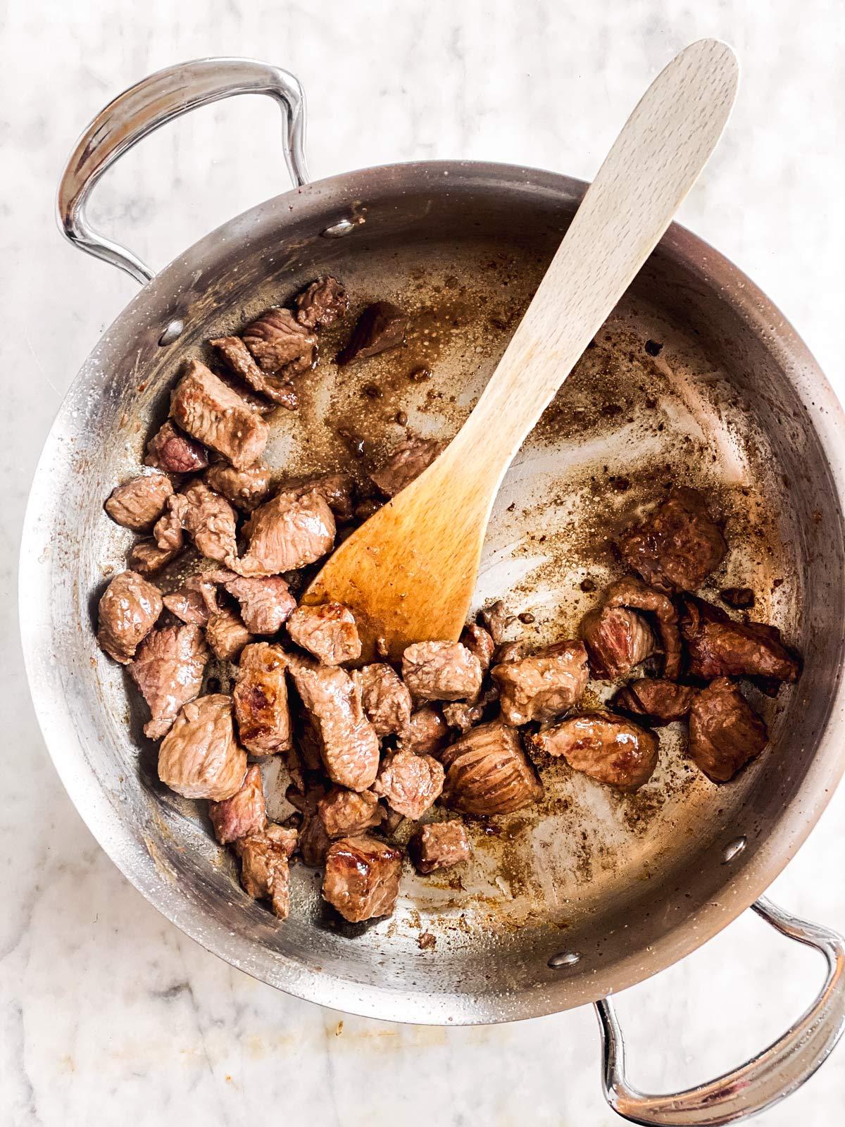 beef stew meat browned in skillet