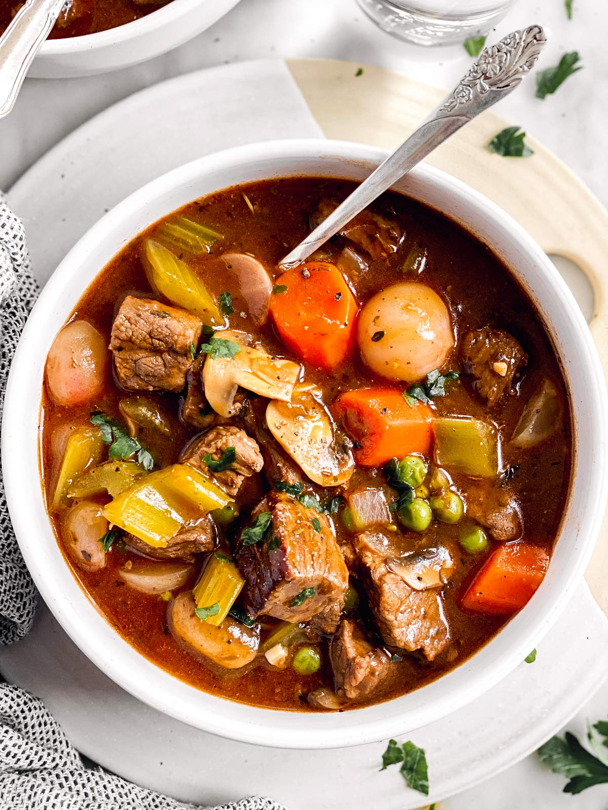 overhead view of keto beef stew in a white bowl