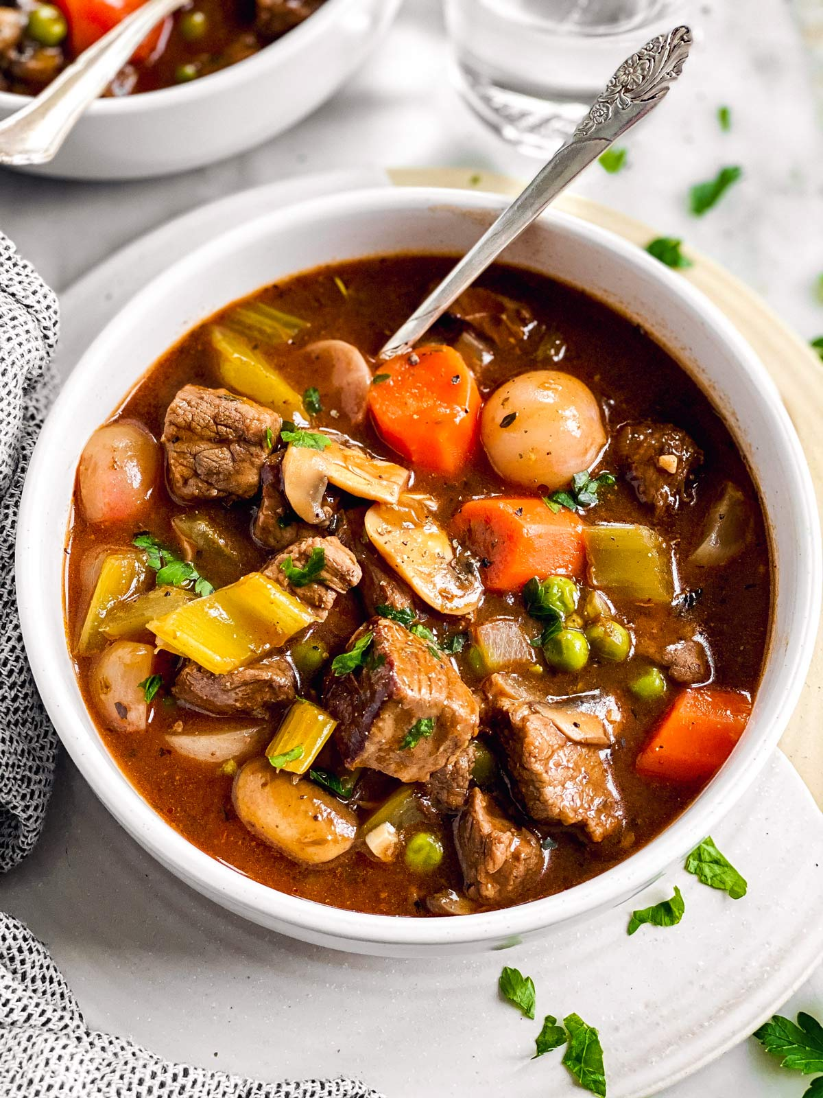 close up photo of white bowl with beef stew