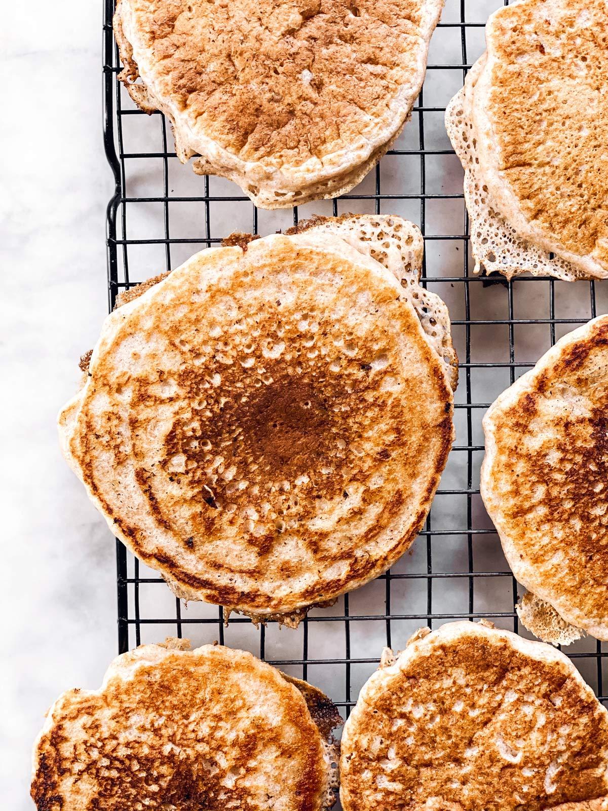 sourdough pancakes on black wire rack