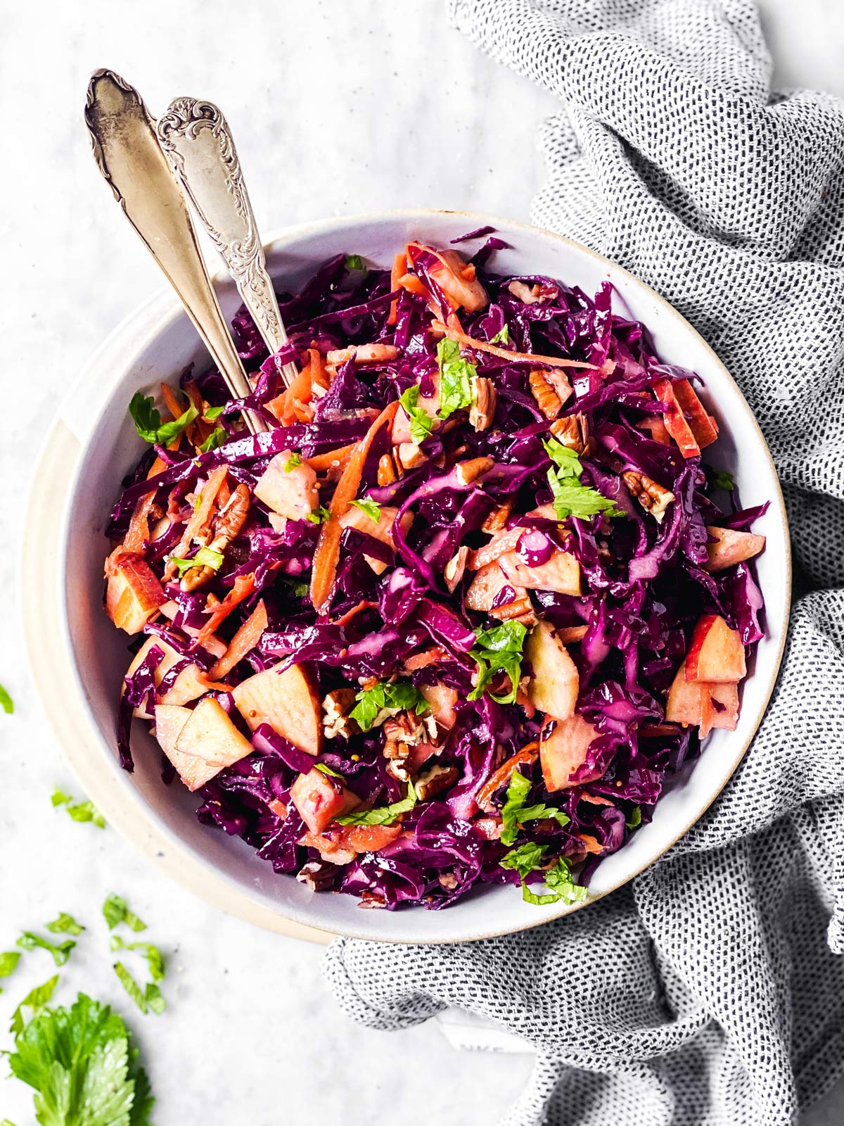 overhead view of white bowl with red cabbage salad
