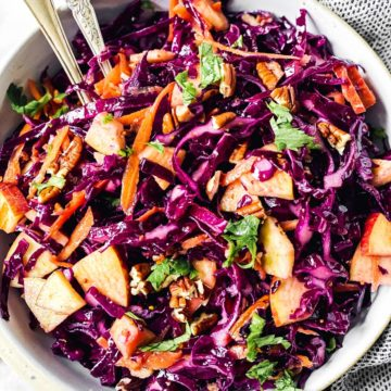 overhead close up of red cabbage salad in white bowl