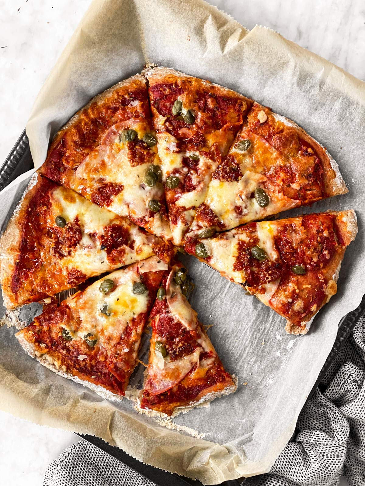 overhead view of pizza made with whole wheat dough