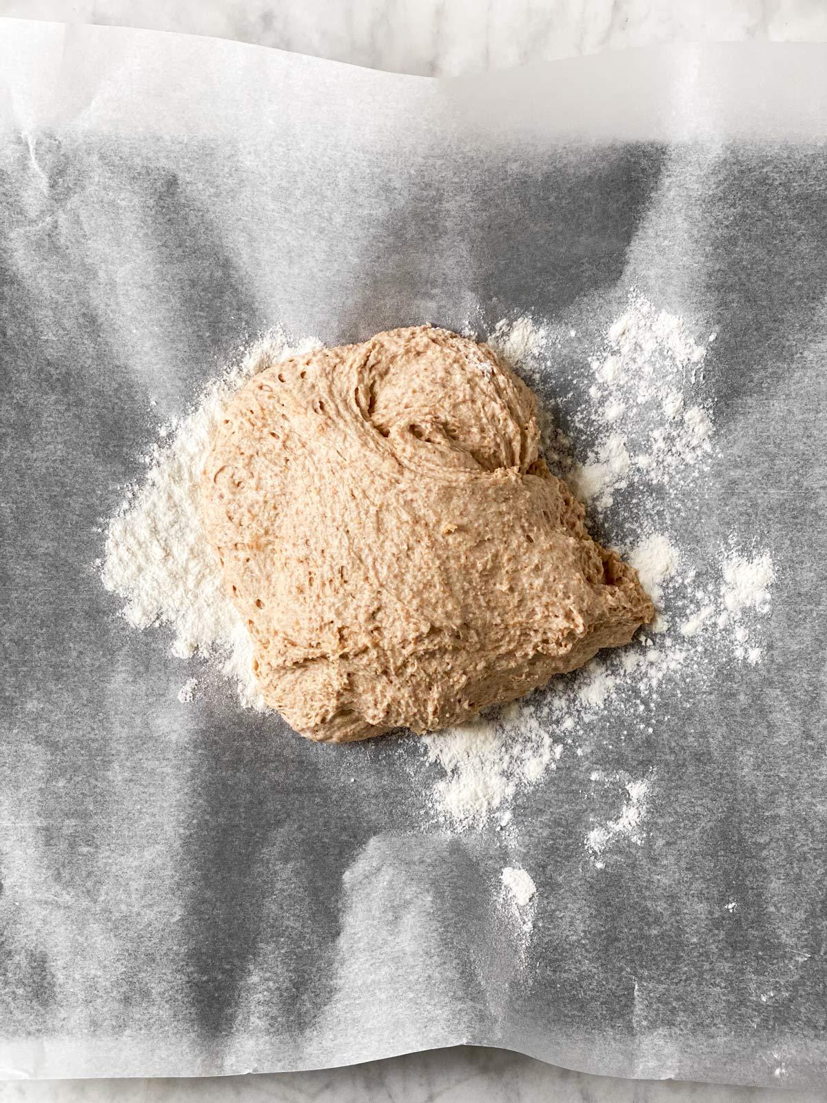 pizza dough on baking parchment